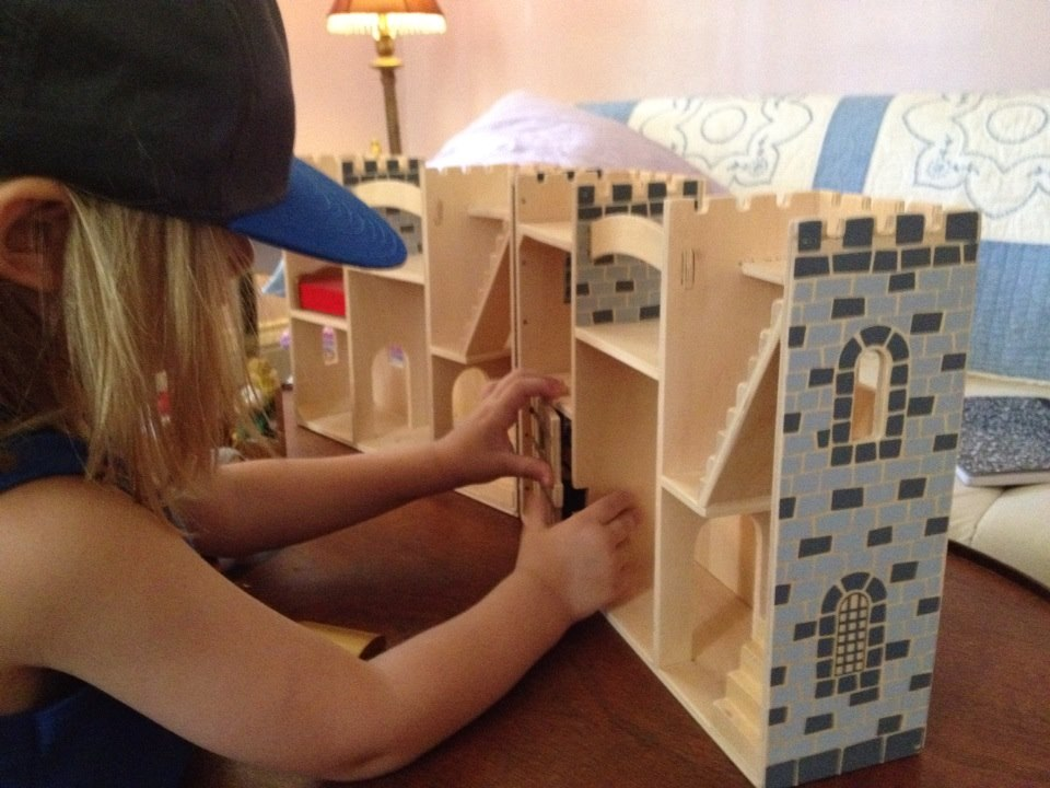 Child Playing with Castle